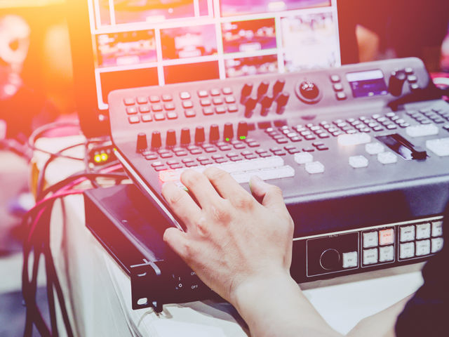Professional video editor footage switching on stage duty vintag