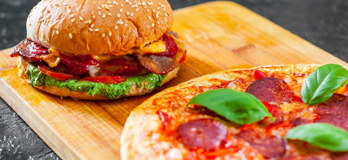 bacon cheese burger with beef patty tomato onion and Pizza with Mozzarella cheese, Ham, Tomatoes, salami, pepper, pepperoni Spices and Fresh Basil